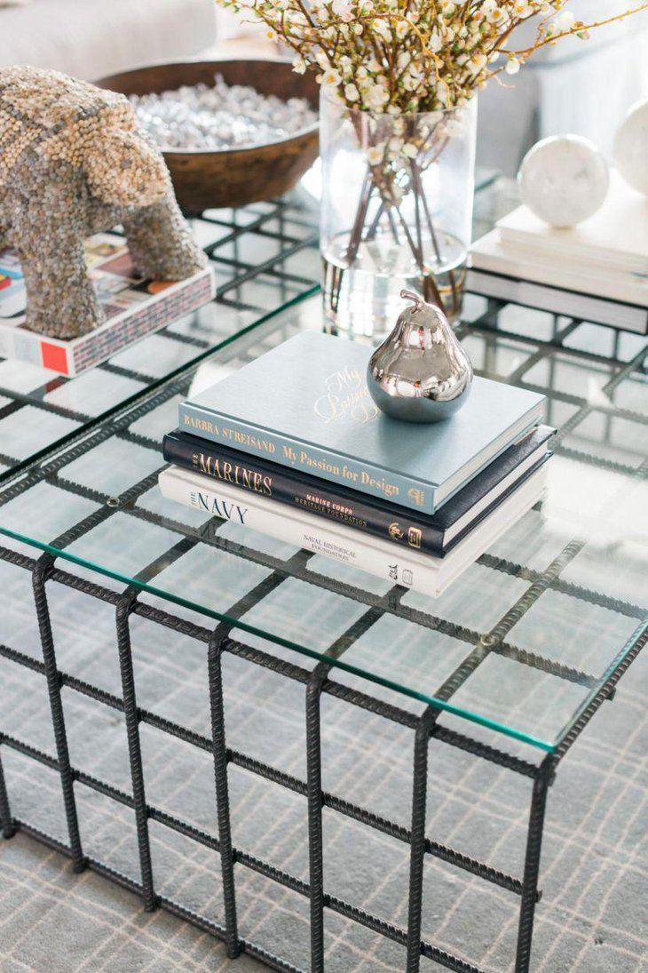 Stylish book decor with silver pear on coffee table