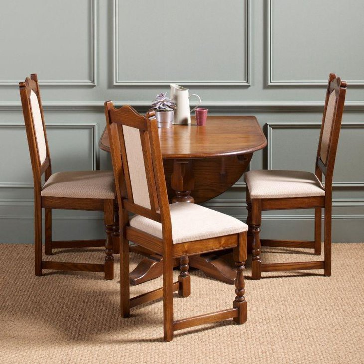 Stylish drop leaf dining table set with white upholstery