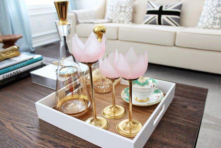 Stylish golden decanter and glasses decor on coffee table