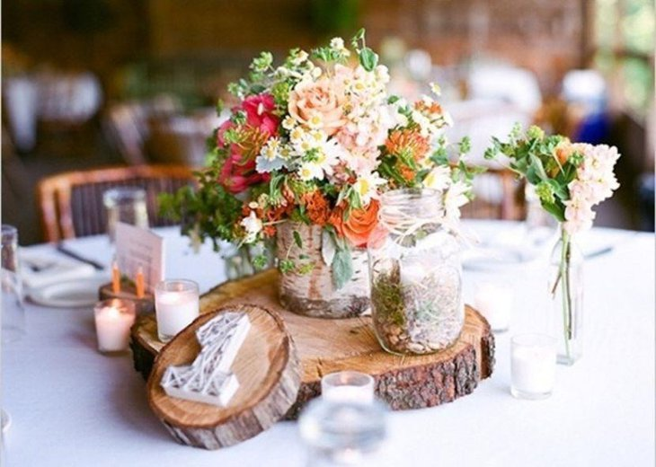 Stylish rustic vase and wooden slab centerpiece