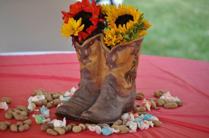 Summary boots with flowers birthday table centerpiece