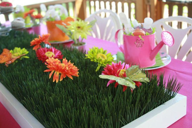 Summer garden party table decor with fresh flowers and grass centerpiece