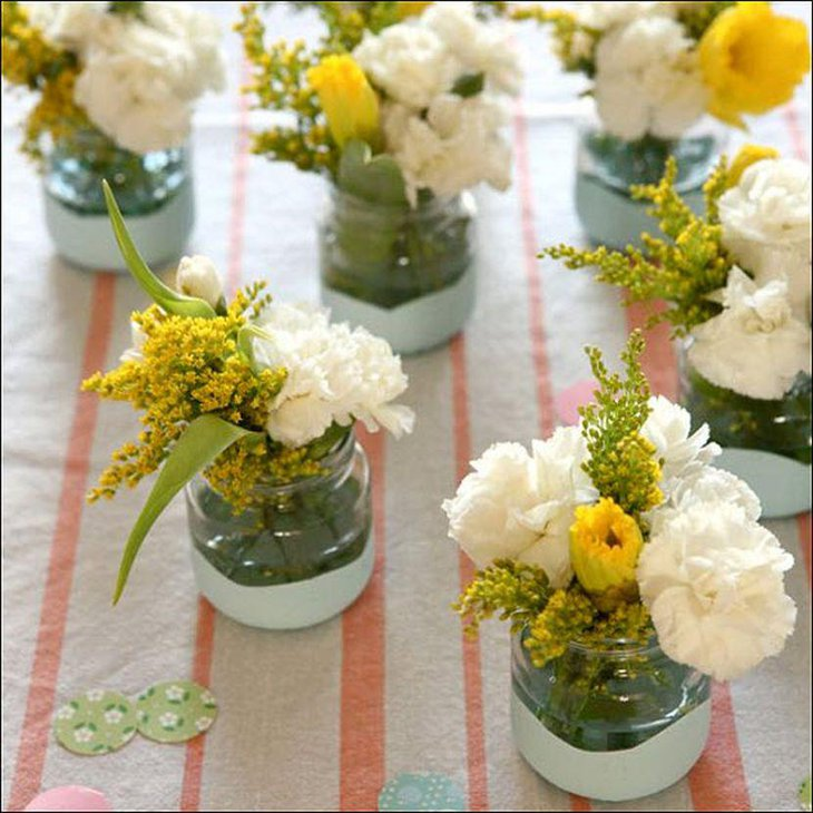 Summer garden party table decor with short glass vases