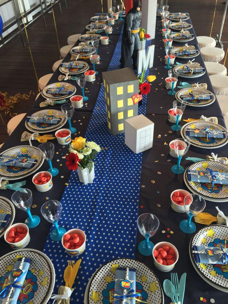Superhero birthday table decor with flowers