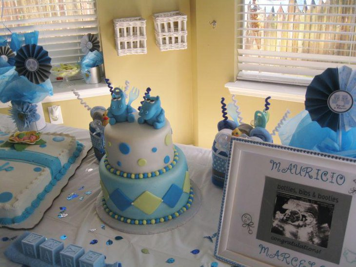 Sweet blue accented twin baby shower table decor