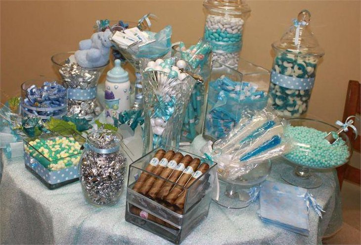 Sweet blue baby shower candy table decor with blue candy and baby bottle