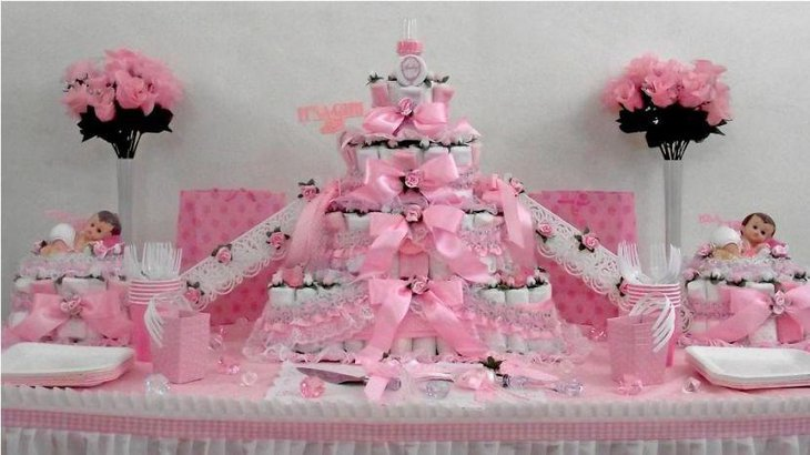 Sweet butterfly themed diaper cake centerpiece on baby shower table