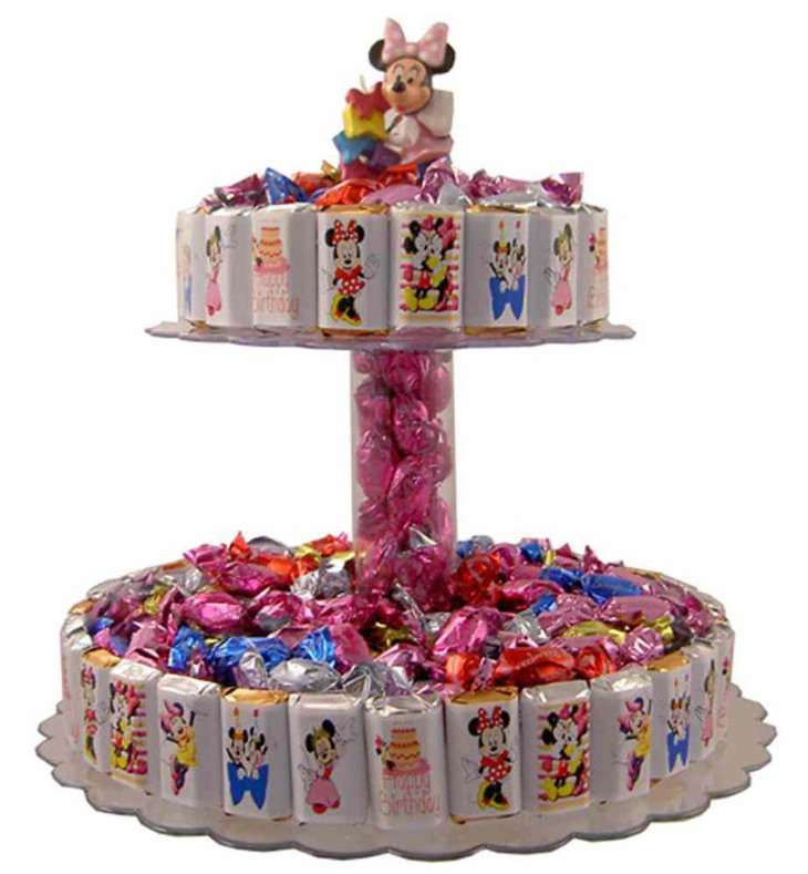 Sweet Minnie Mouse candy bar cake centerpiece idea on candy table