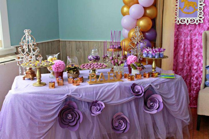Sweet purple themed baby shower candy table decor