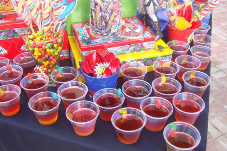Table for drinks and candies for exciting Spiderman birthday party