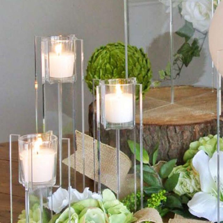 Tall acrylic votive candle centerpiece on wedding table