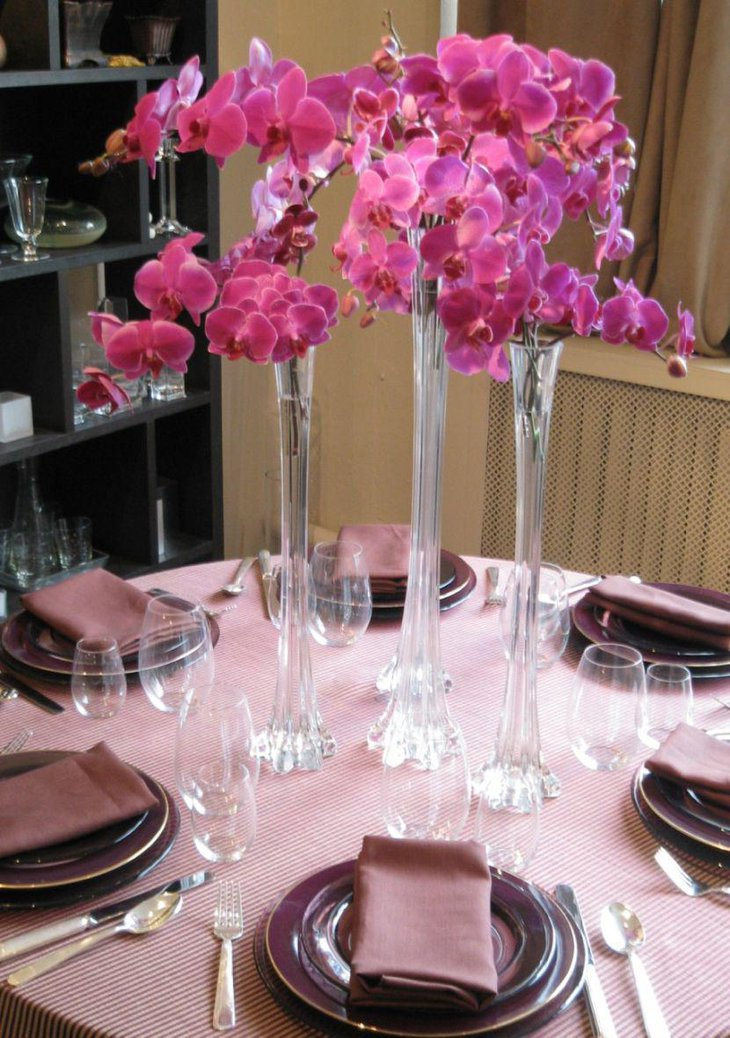 Tall glass vase centerpieces on spring table