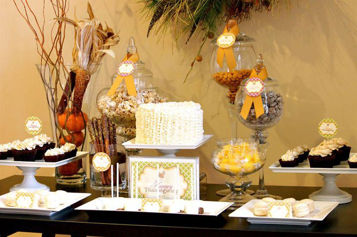 Thanksgiving dessert table decor with couture cake and vases filled with dry corncobs and pumpkins