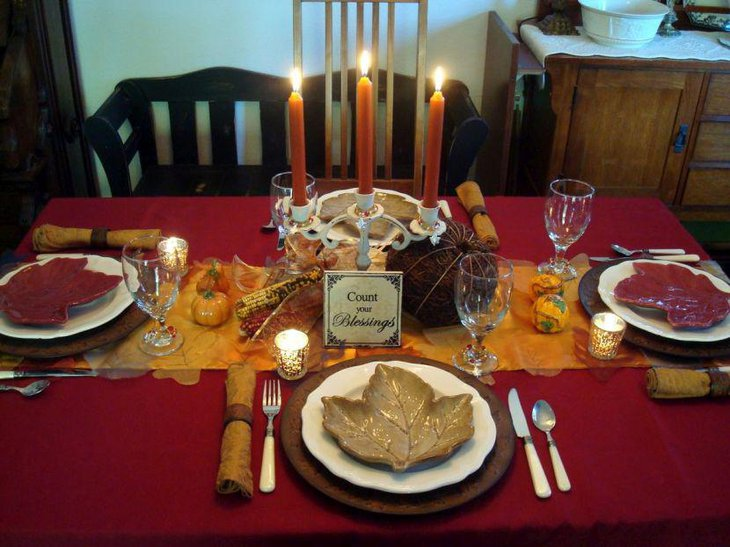 Thanksgiving table decor with Orange candles and white holder
