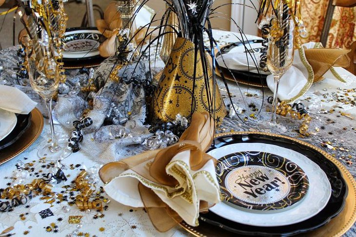 The Black White and Golden New Years Eve Celebration Party Table Decoration