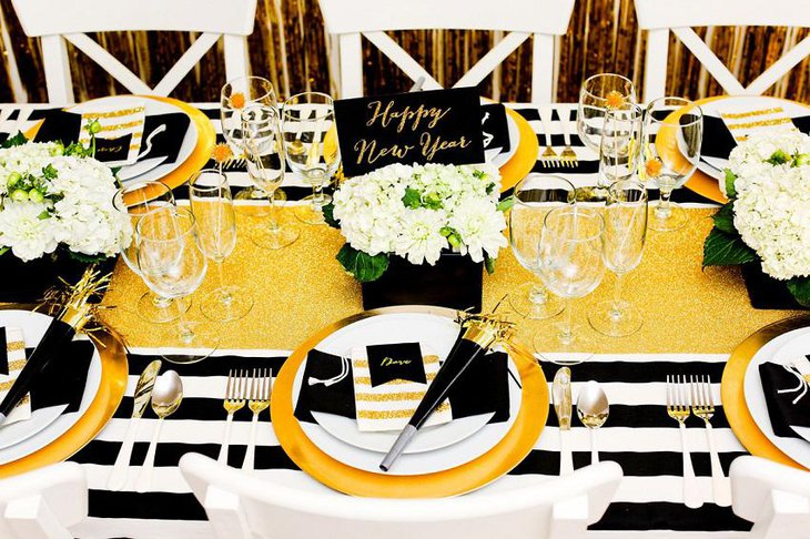 The Black White and Golden New Years Eve Flowery Party Table Decoration