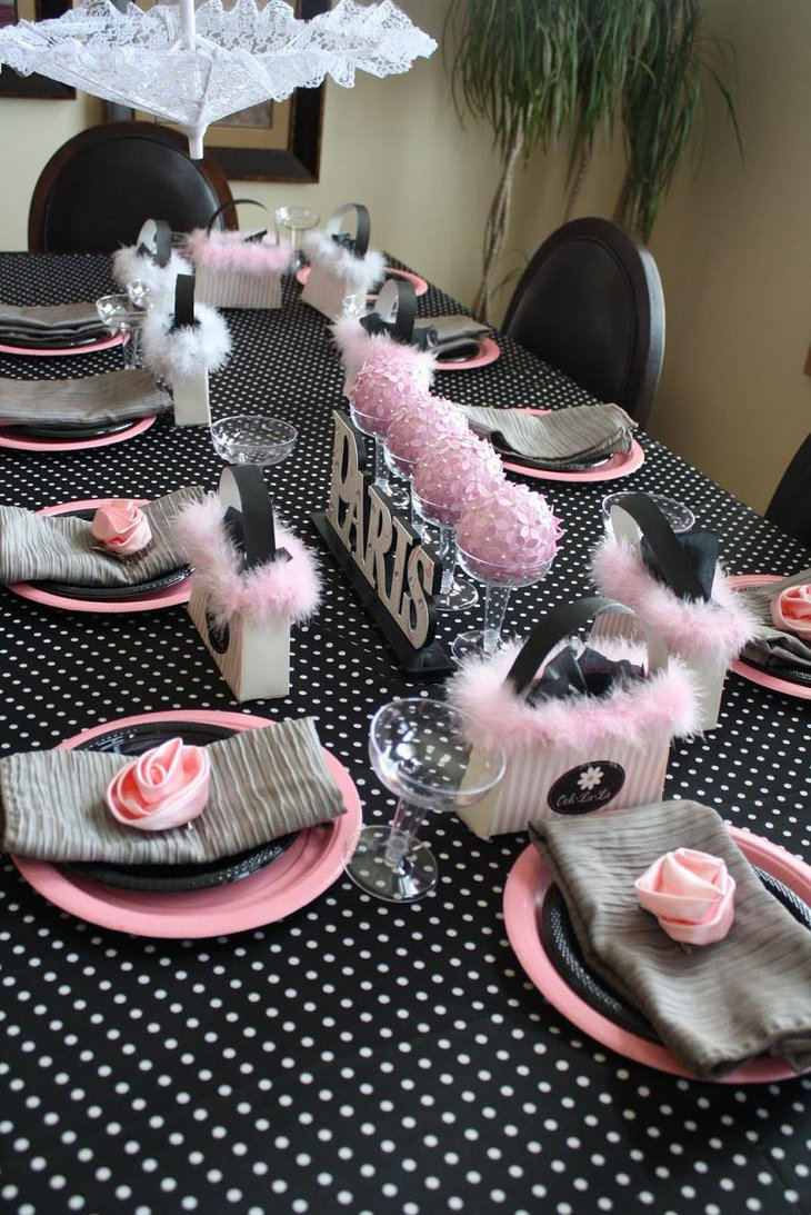 The Black White and Red New Years Eve Paris Themed Party Table Decoration