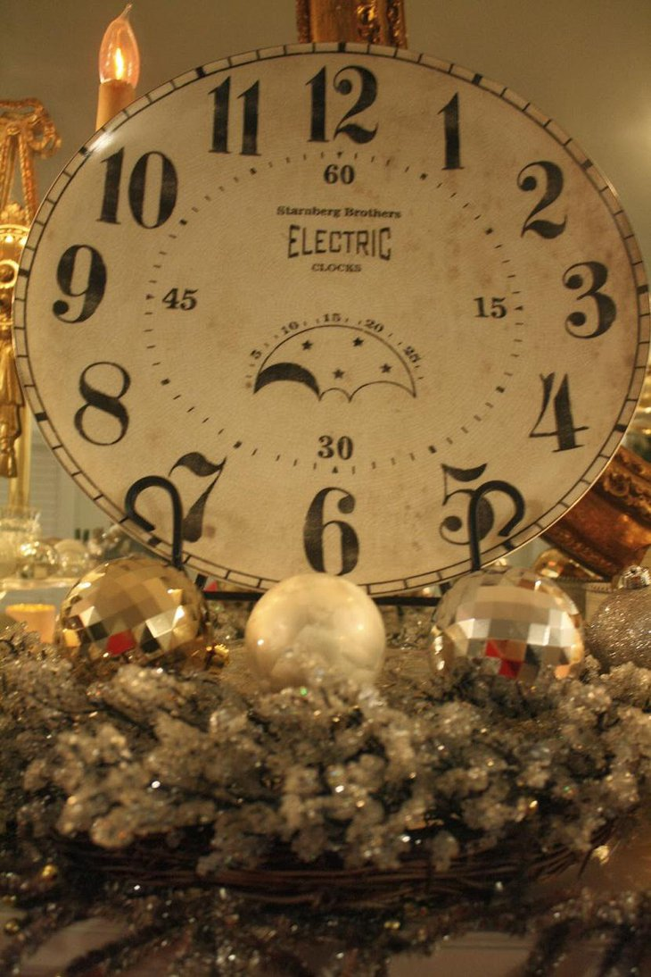 The Table Centerpiece for New Years Eve with a Gaint Clock and Silver Balls