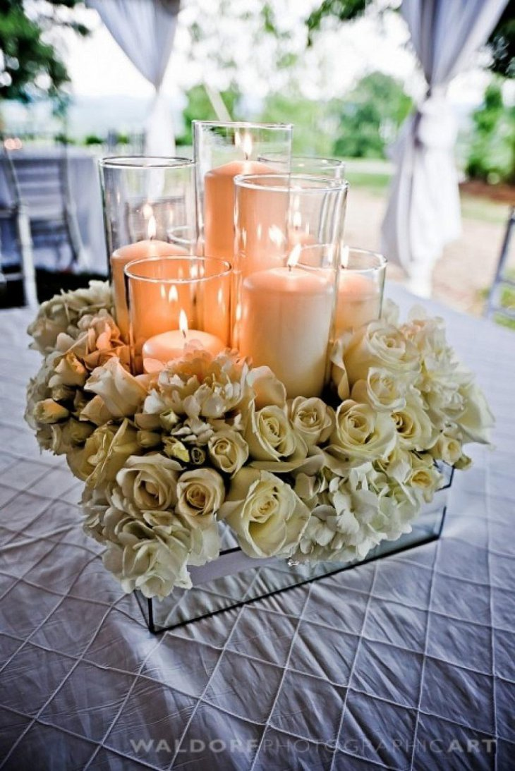 The Table Centerpiece for New Years Eve with Candles and Cream Flowers