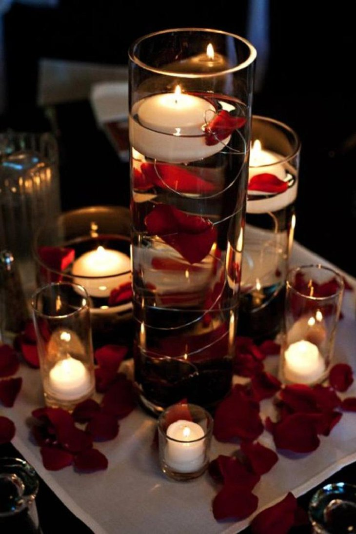 The Table Centerpiece for New Years Eve with Candles and Rose Petals