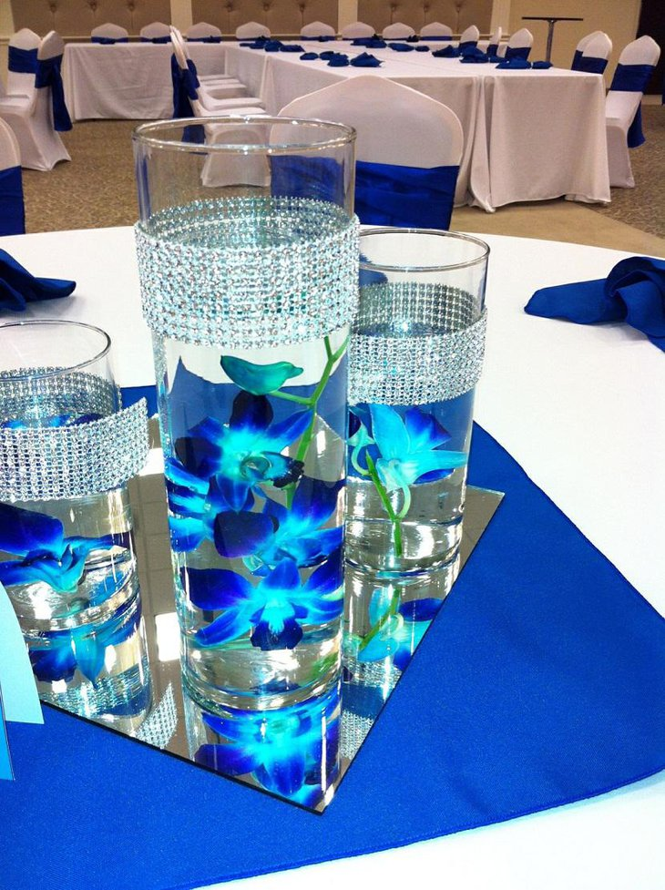 The Table Centerpiece for New Years Eve with Candles in Blue Flower Vase