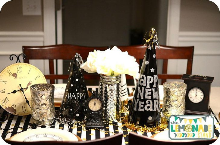 The Table Centerpiece for New Years Eve with Clocks and Hats