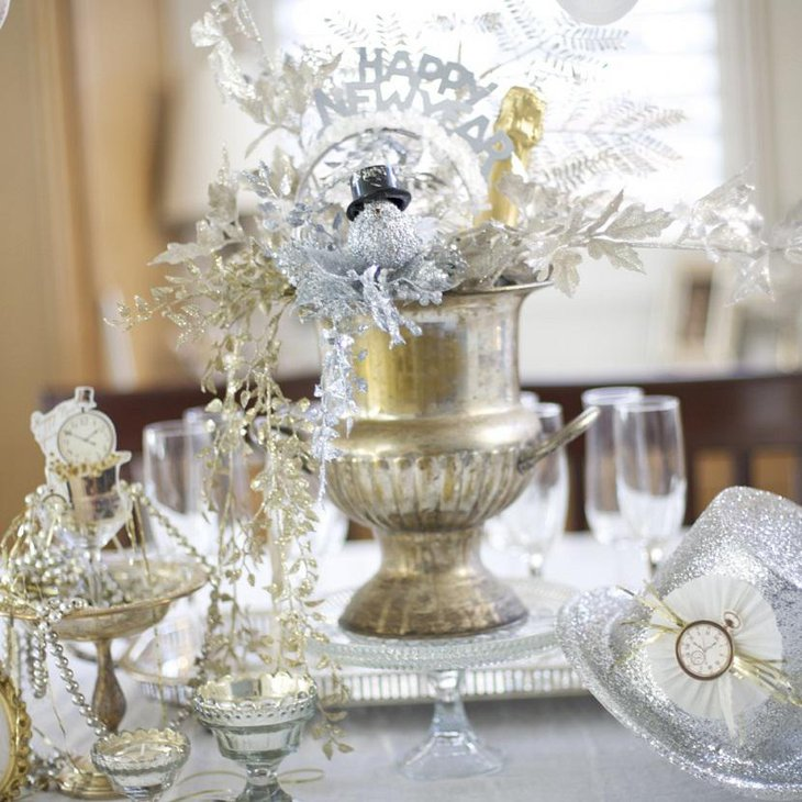 The Table Centerpiece for New Years Eve with Crystal Bowls and Hats