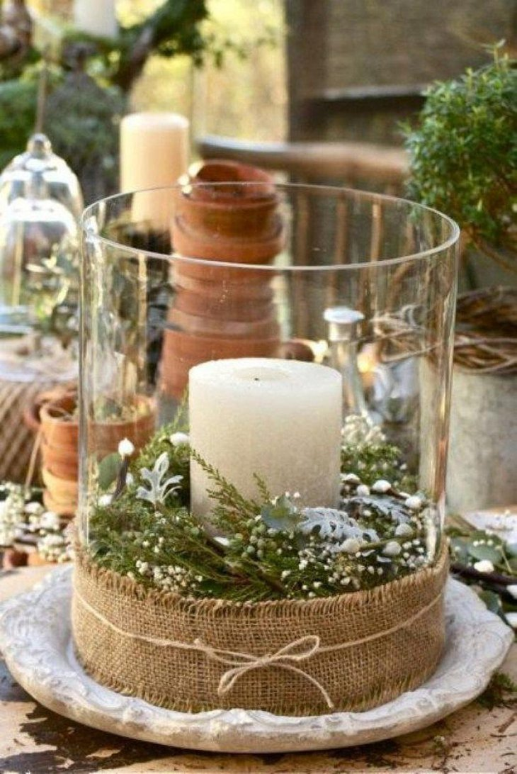 The Table Centerpiece for New Years Eve with Green Leaves and Candle
