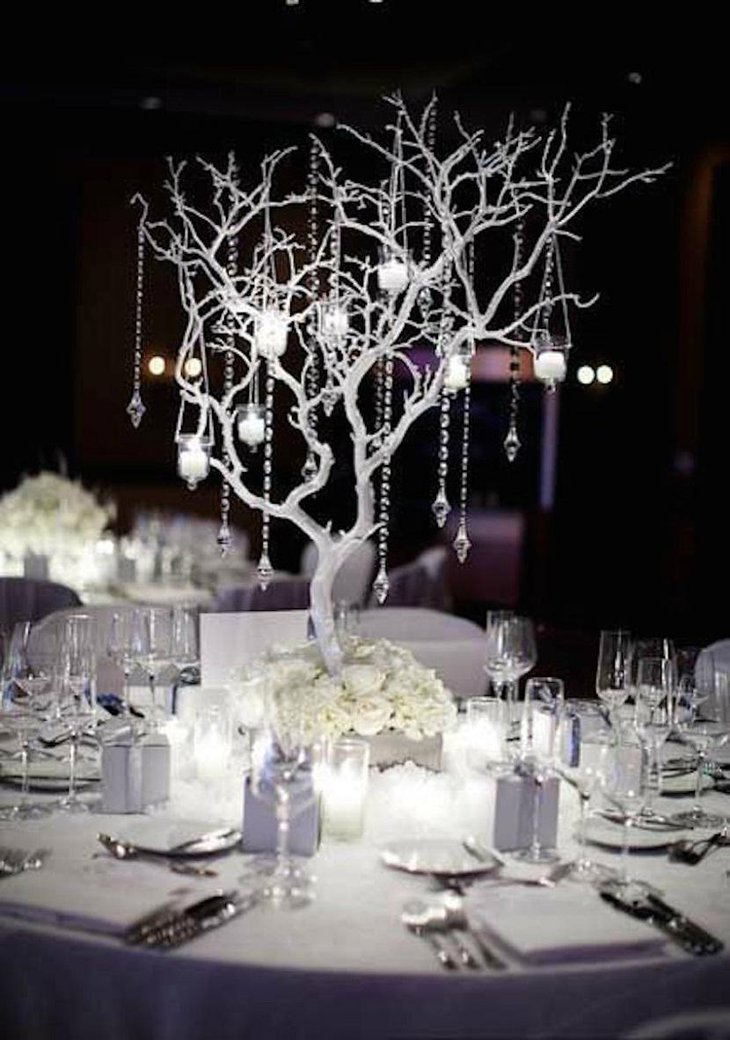 The Table Centerpiece for New Years Eve with Hanging Crystals on a Tree