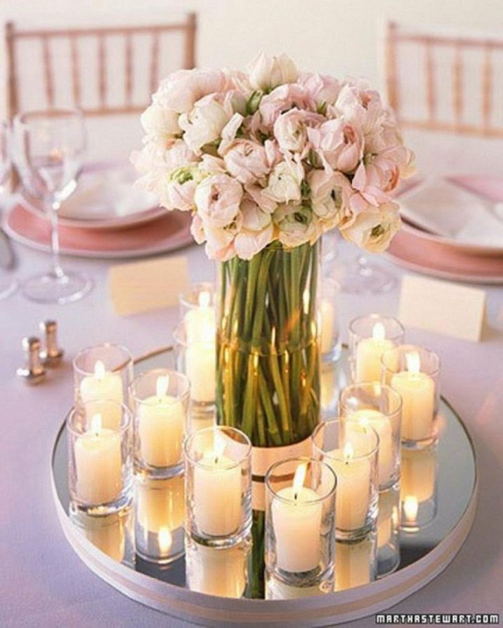 The Table Centerpiece for New Years Eve with Pink Flowers and Candles