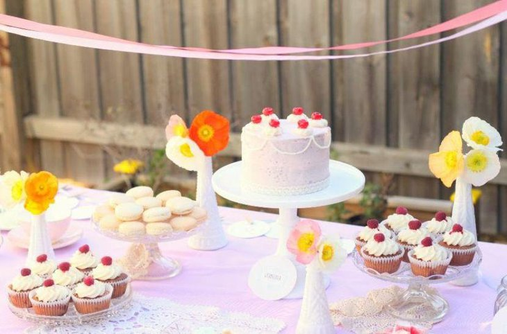 This bridal shower cake table looks stunning with colourful flowers