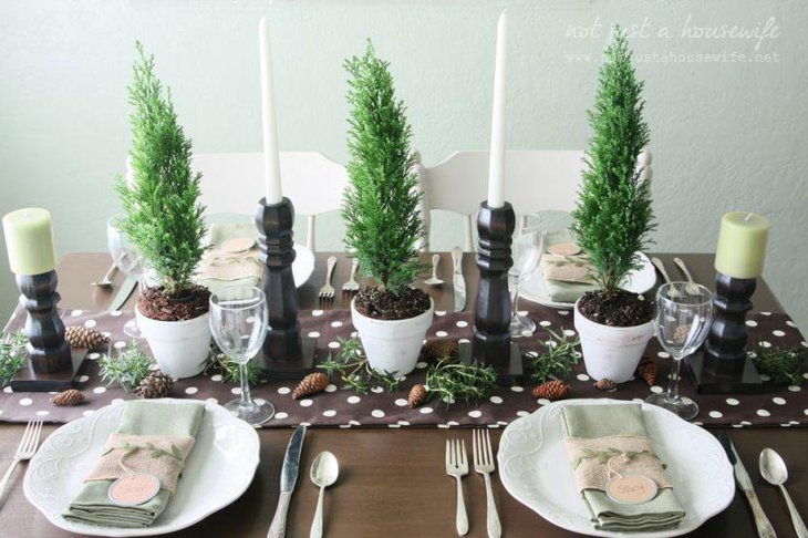 This chocolaty Christmas table looks warm with candles and planters