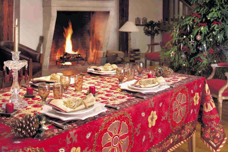 This Christmas tablescape looks grand with a red patterned tablecloth