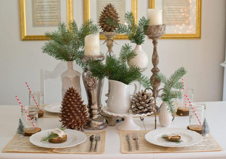 This DIY Christmas table is decked with pine cones mason jars and candles