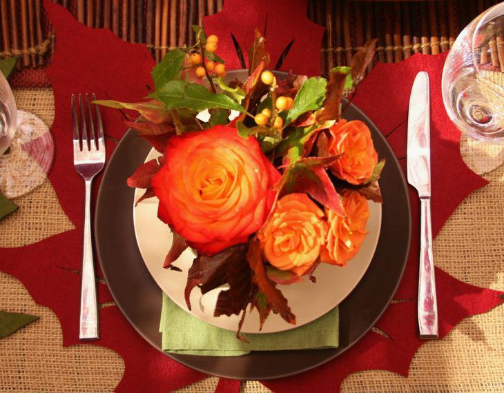 Trendy Thanksgiving Decor With Bright Red Maple Leaf Mat And Floral Arrangement