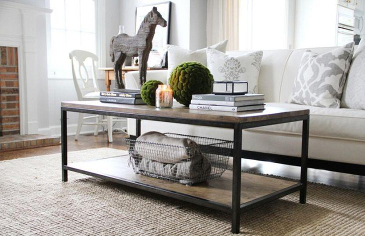Unique coffee table setting with books and horse figurine