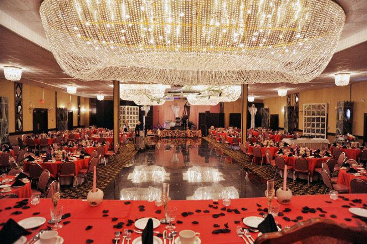 Unique wedding table setup with red and black theme