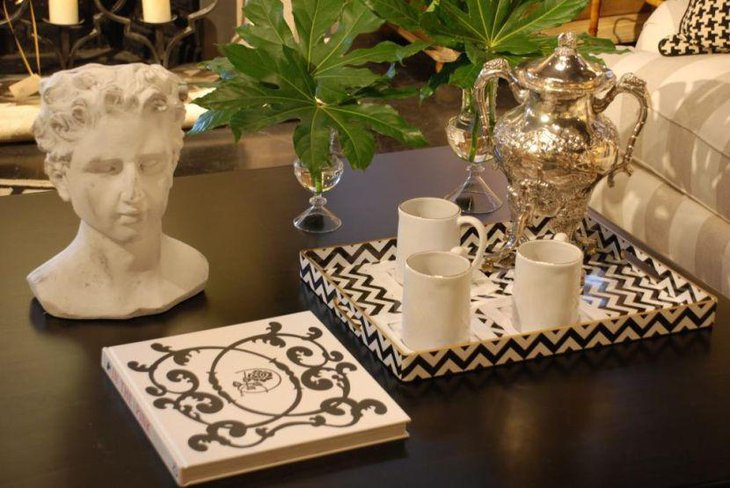 Unique white sculpture and printed tray as coffee table centerpieces