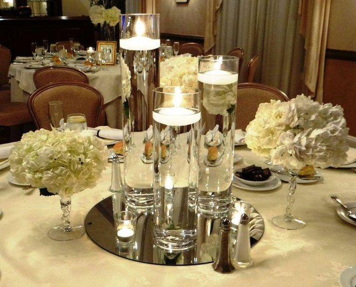 Unique winter party table decorations with floating candle centerpieces