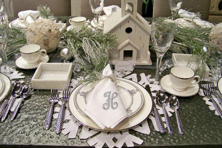 Unique winter table decoration with snowflake mats and place card holders