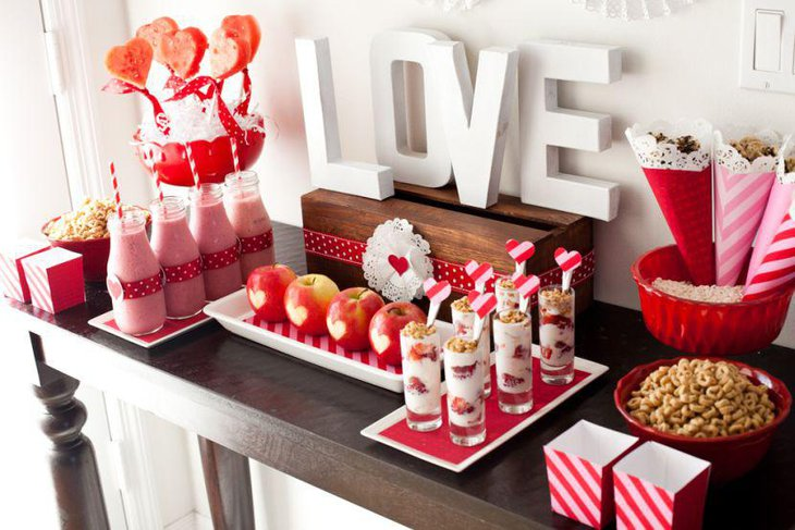 Valentines dessert table decor with heart lollipops
