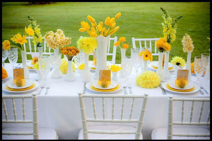 Vibrant garden party table decor with yellow flowers