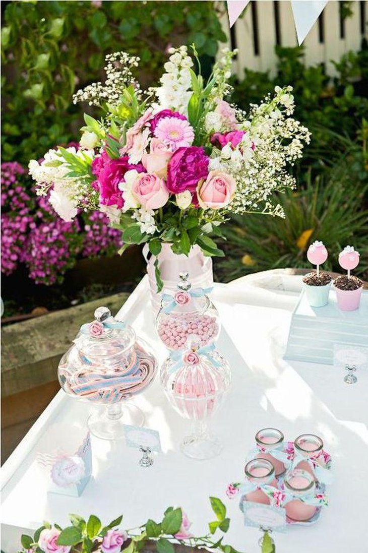 Victorian garden party table decor with cute vases