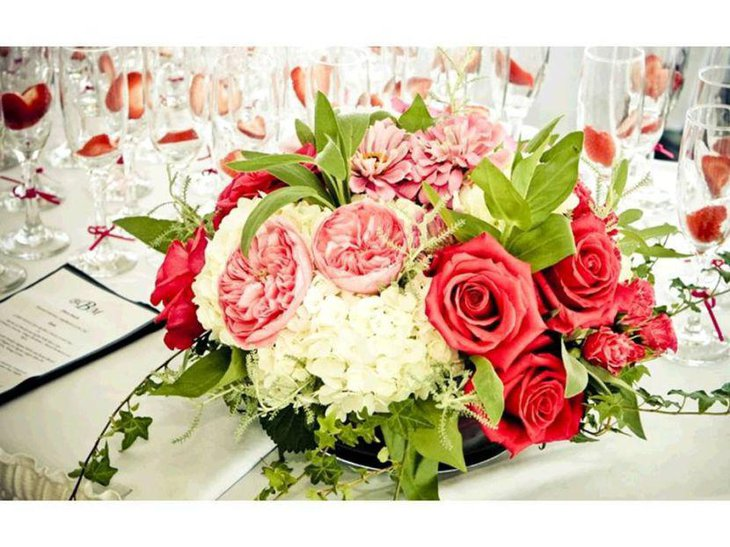 Vintage coral flower centerpiece on wedding table