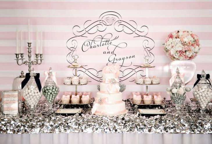 Vintage dessert table in vintage style with candelabras and flower decoration