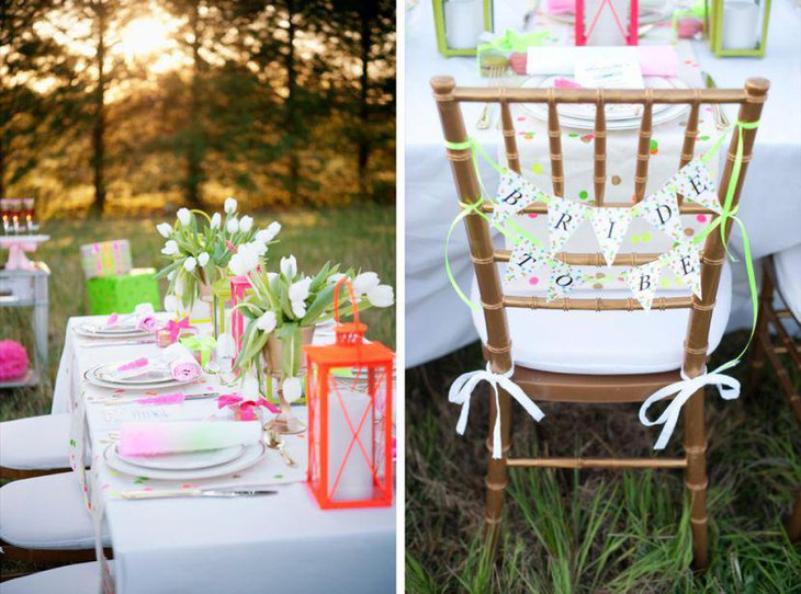 Vintage pink and white party table decor with flowers and vintage lantern