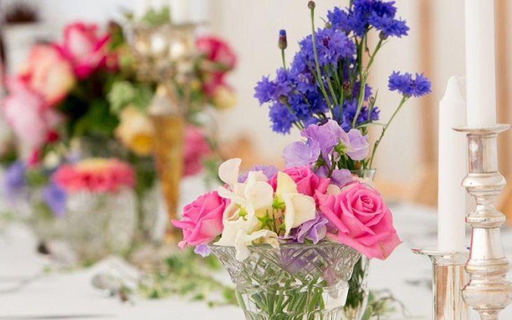 Vintage purple and pink floral wedding table decor