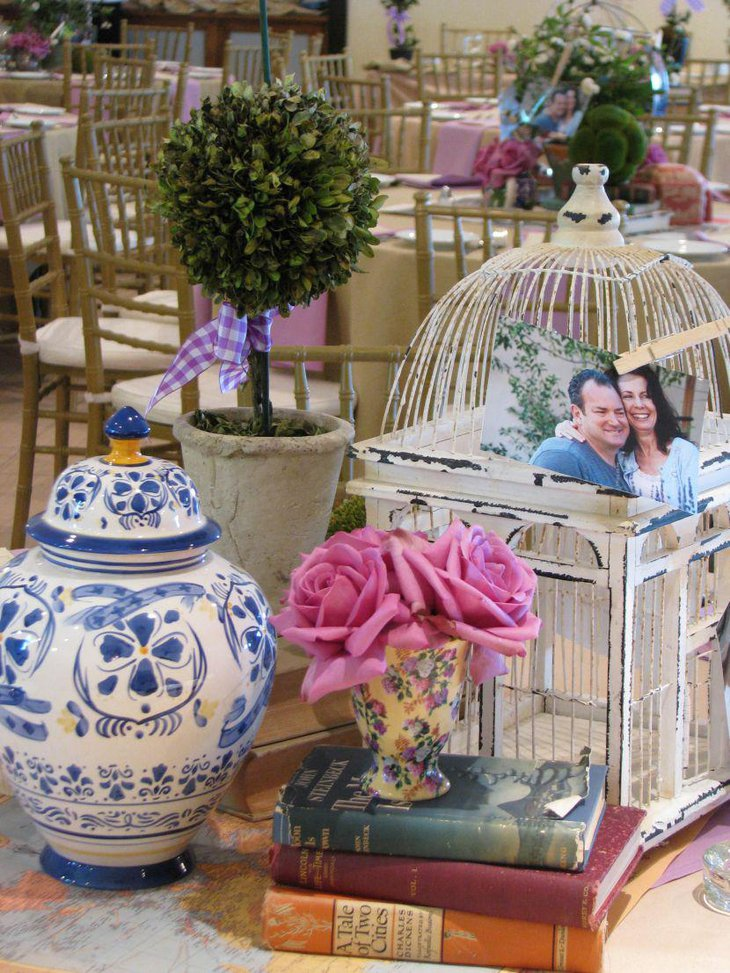 Vintage wedding table decor with cage flowers and book vignette