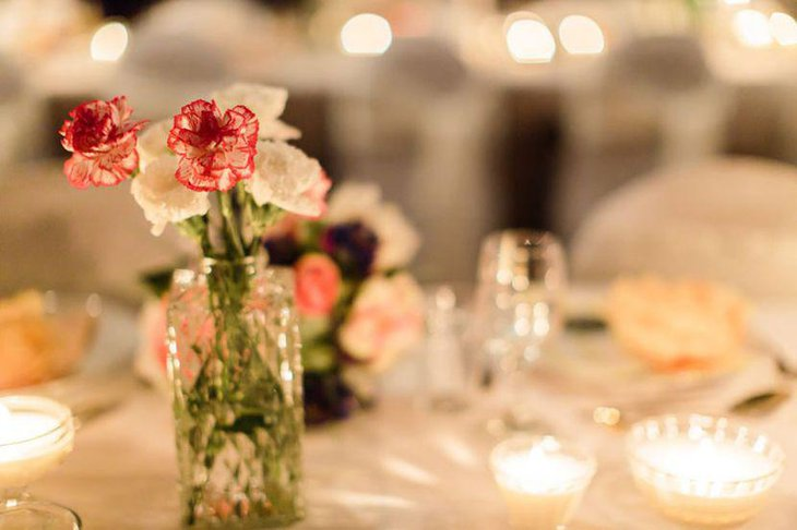 Vintage wedding table decor with floral vase