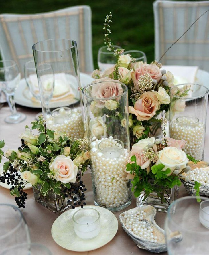 Vintage wedding table decor with jars filled with pearls